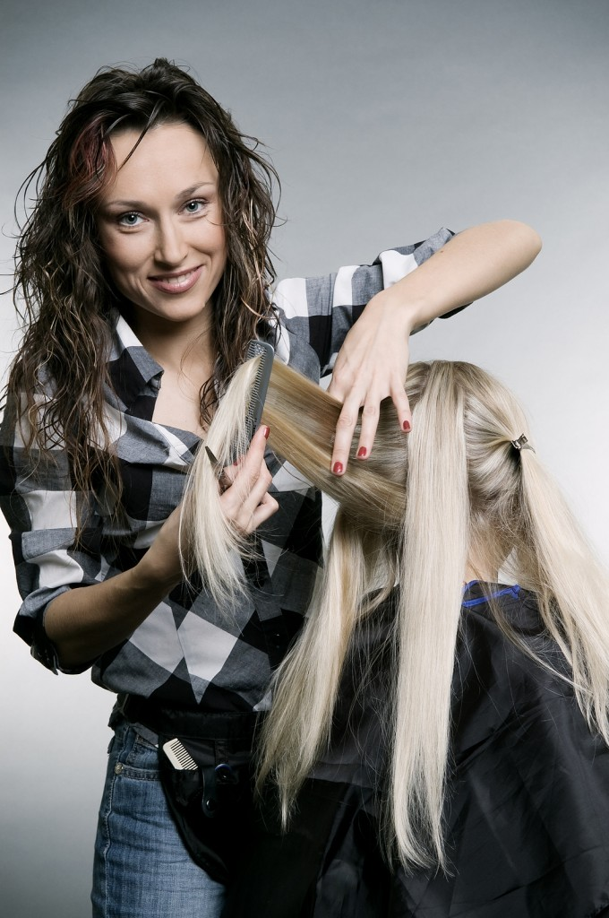 bigstock_Smiley_Hairdresser_Doing_Hairs_6886229